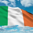 Stock Video: Ireland flag waving against time-lapse clouds background