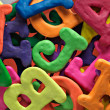 Plasticine alphabet texture background - Foto Stock