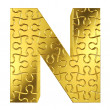 Puzzle letter N in gold metal on a white isolated background. — Stock Photo