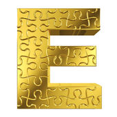 Puzzle letter E in gold metal on a white isolated background — Stock Photo