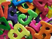 Plasticine alphabet texture background — Stock Photo