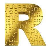 Puzzle letter R in gold metal on a white isolated background — Stock Photo