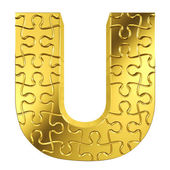 Puzzle letter U in gold metal on a white isolated background — Stock Photo