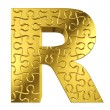 Puzzle letter R in gold metal on a white background — Stock Photo