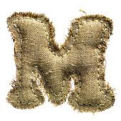письмо льняная ткань винтаж м, изолированные на белом — Стоковое фото