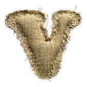 Linen vintage cloth V letter isolated on white — Stock Photo