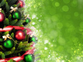 Magically decorated Christmas Tree with balls, ribbons and red garlands — Stok fotoğraf