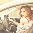 Beautiful young woman in luxury car — Stock Photo