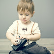 Baby boy with camera — Stock Photo #39351849