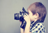 Baby boy with camera — Stock Photo