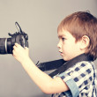 Stock Photo: Baby boy with camera