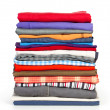 Stock Photo: Stacks of colorfull clothes on white background