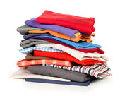 Stacks of colorfull clothes on white background — Stock Photo