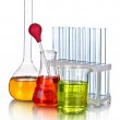 Laboratory glassware with color liquid and with reflection isolated on white — Stock Photo #13860867