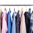 Row of colorful row shirts hanging on hangers — Stockfoto