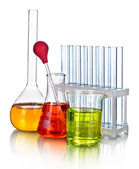 Laboratory glassware with color liquid and with reflection isolated on white — Stock Photo