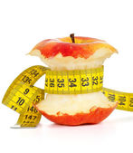 Apple core and measuring tape — Stock Photo