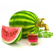 Watermelon faucet with watermelon juice — Stock Photo