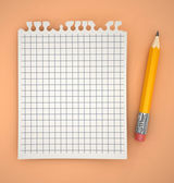 Sheet of paper with pencil — Stockfoto