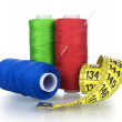 Few bobbins thread with needle and measuring tape of tailor — Stock Photo