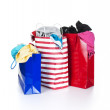 Stock Photo: Paper shopping bags full of clothes