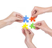 Hands and puzzle — Stock Photo