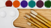 Paint and paintbrush — Stock Photo