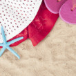 Beach items with towel,flip flops and starfish on a sand background — Stock Photo #37820471