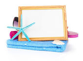 Beach items with towel,flip flops,starfish, sunglasses and a white frame — Photo