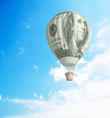 Hot air balloon with one hundred dollar banknote — Stock Photo
