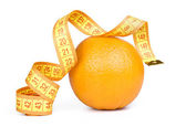 Orange fruit with tape measure — Stock Photo