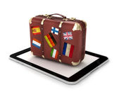 Travel Concept with tablet and suitcase — Foto de Stock