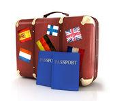 Vieja maleta con banderas pasaportes y rayas — Foto de Stock