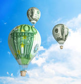 Money bills Hot Air Balloon in the Sky — Stock Photo