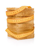Bread grasped by measuring tape — Stock Photo