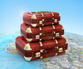 Travel suitcases in stack on global — Stock Photo