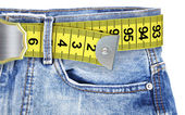 Jeans with measuring tape — Foto de Stock