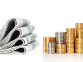 Newspapers with stack of coins — Stok fotoğraf