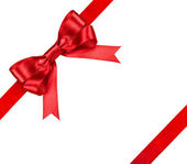 Composition with red ribbons and a bow isolated on white — Stock Photo