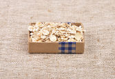 Oat flakes on linen — Stock Photo