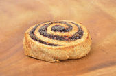 Spiral poppy seed cookie — Stock Photo