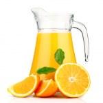 Постер, плакат: Orange juice in pitcher and oranges