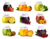 Set of glass jars with exotic fruits jam isolated — Stock Photo
