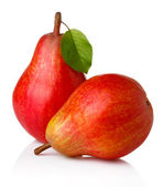Ripe red pear fruits with green leaves isolated — Stock Photo