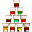 Pyramid of short colored alcohol cocktails isolated on white — Stock Photo