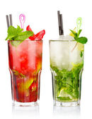 Two mojito cocktails with strawberry and lime fruits isolated — Stock Photo