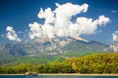 Beautiful landscape (Turkey). Mountain over cloudscape and seac — Stock Photo