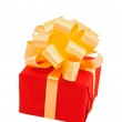 Red gift box with beige bow — Stock Photo #1771887