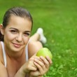 Beautiful young girl with green apple — Stock Photo #11307190
