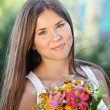 Beautiful young girl in summer park — Stock Photo #12050435
